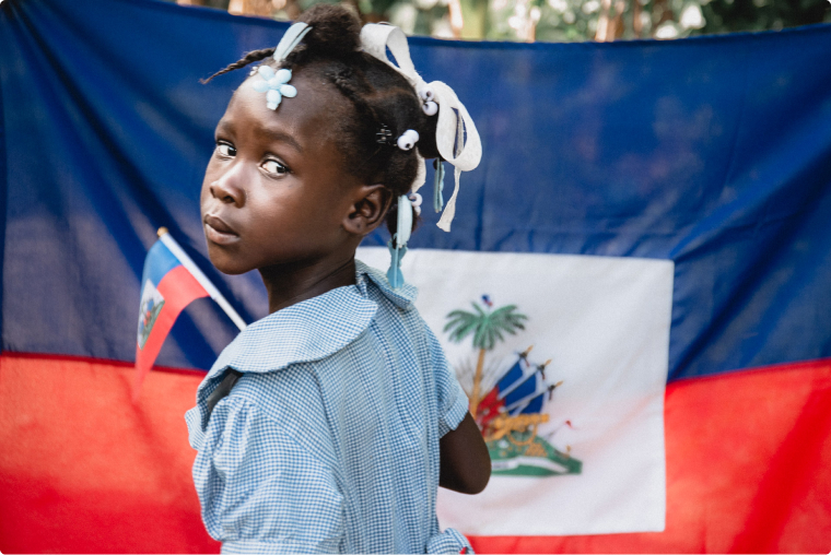 young girl with the haiti flag